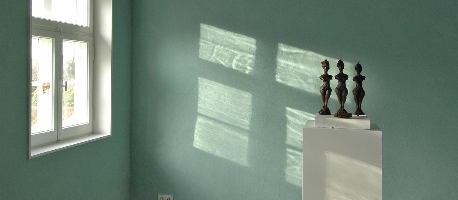 3 menschliche Glasskulpturen
